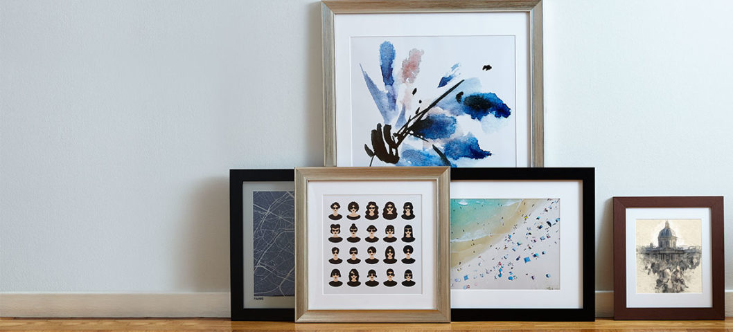 Gallery wall made of framed photo prints with wedding photos and metallic picture frames