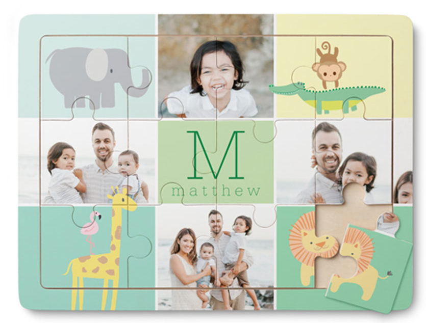 Wooden puzzle with 12 pieces showing monogram in the middle and images of family along with zoo animals