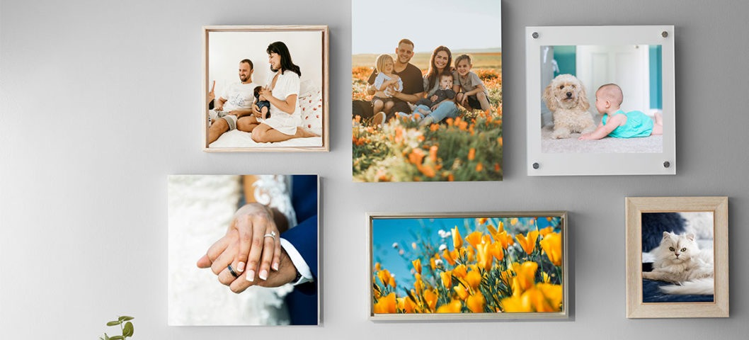 Gallery wall with six different photo prints in a variety of sizes and materials, including canvas print and acrylic prints