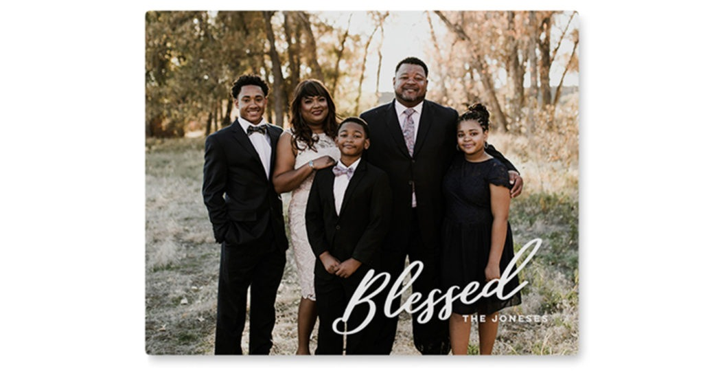 Metal photo print with family photo and blessed caption with script white font
